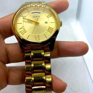 Men's guess watch gold colour